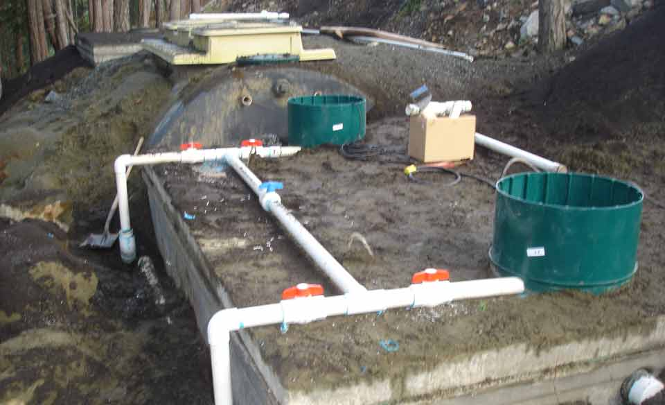 Forced main manifold installation to pump chamber